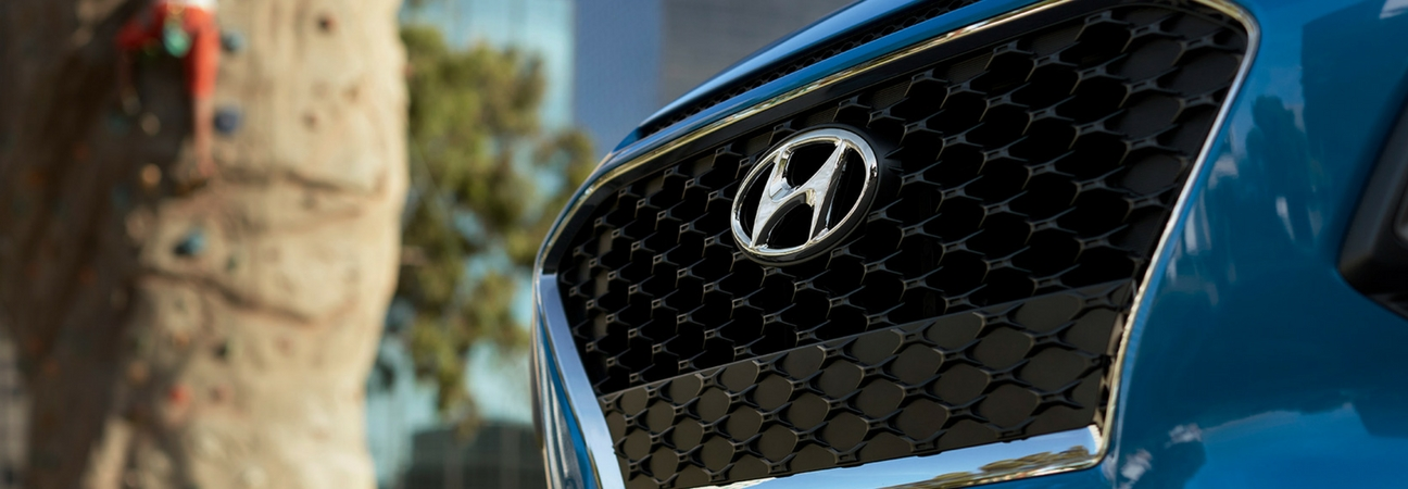 A close up of a Hyundai grill featured in a blog post about Hyundai fuel efficiency