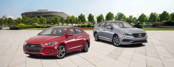 Two Hyundai sedans in a parking lot