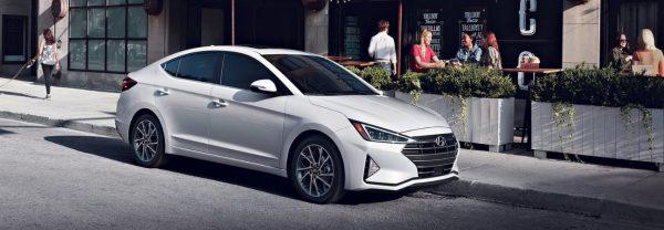 White 2019 Hyundai Elantra parked outside restaurant