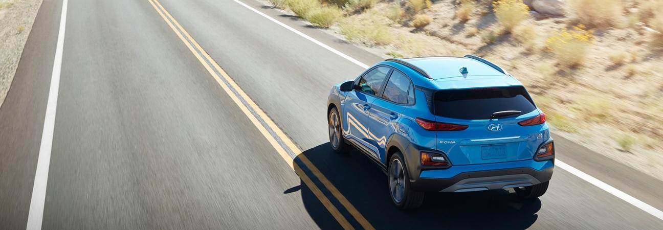 Blue 2019 Hyundai Kona traveling down the road